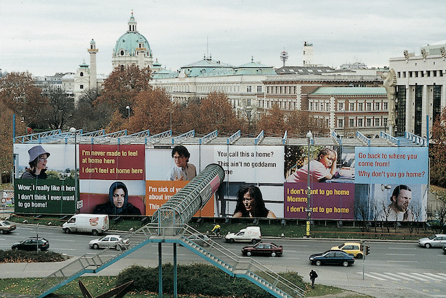 Coloured, aerial view of billboards highlighting different meanings of 'home'.