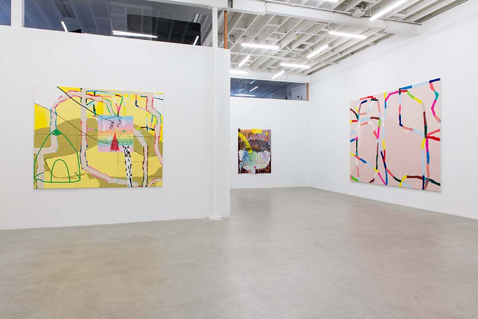 Installation of an a bright art gallery with three very large abstract paintings on the wall.
