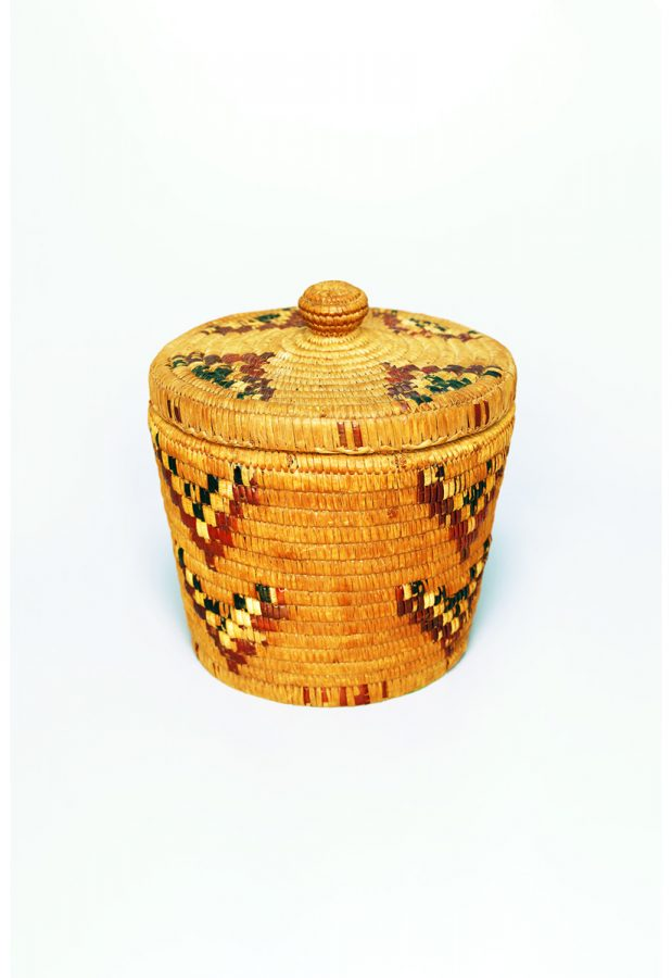 Image of a woven coiled basket with arrow pattern details.