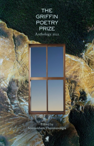 Cover of The Griffin Poetry Prize Anthology 2021. Foreground, window. Background, rock formation and trees.